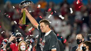 Tampa Bay Buccaneers quarterback Tom Brady celebrates with the Vince Lombardi Trophy after the NFL Super Bowl 55