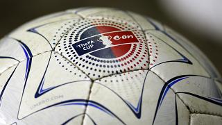 A football with an FA Cup logo sits on the sideline