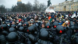 Protesters in St. Petersburg, Russia, clash with police over the jailing of opposition leader Alexei Navalny on Jan. 23, 2021.