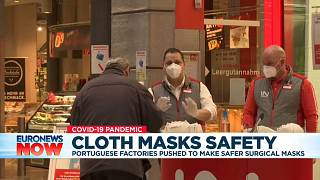 Workers wear FFP2 face masks