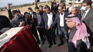 Passengers cross the Rafah border after Egypt re-opens it