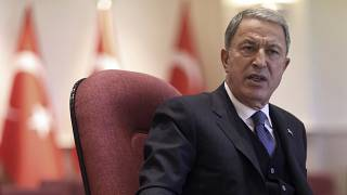 Turkish Defense Minister Hulusi Akar speaks during a news conference in Ankara.