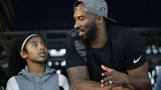 In this July 26, 2018, file photo, former Los Angeles Laker Kobe Bryant and his daughter Gianna watch the U.S. national championships swimming meet in Irvine, Calif.