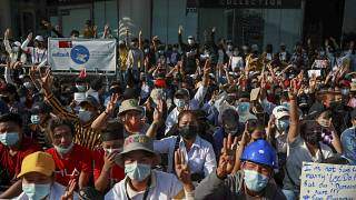 Demonstrator flash three-fingered salutes, a symbol of resistance, during a protest in Yangon, Myanmar, Wednesday, Feb. 10, 2021.