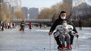 Mann und Kind in Peking.