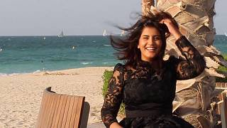 This undated handout picture released on the Facebook page of Saudi activist Loujain al-Hathloul shows her posing for a picture in a dress by a beach.