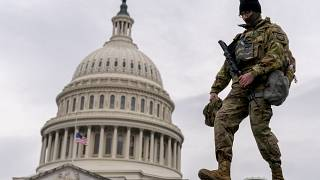 A member of the National Guard walks past the U.S. Capitol during the second impeachment trial of former President Donald Trump in Washington, Wednesday, Feb. 10, 2021.