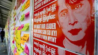 A public notice-board is filled with pictures of national leader Aung San Suu Kyi and notes from demonstrators against the military coup in Mandalay, Myanmar on Thursday, Feb.