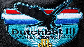 The logo of the Dutchbat III unit seen is pictured outside a courthouse in Arnhem