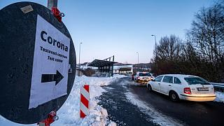 Cars queue in front of a Corona test station at the German-Czech Republic border in Furth im Wald, Germany, Monday, Jan. 25, 2021.