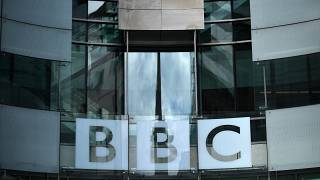 In this file photo taken on July 2, 2020 a BBC sign is displayed outside the BBC headquarters in Portland Place, London.