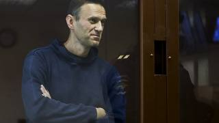 Russian opposition leader Alexei Navalny stands in a cage during a hearing on his charges for defamation, in the Babuskinsky District Court in Moscow, Russia. Feb. 5, 2021.,