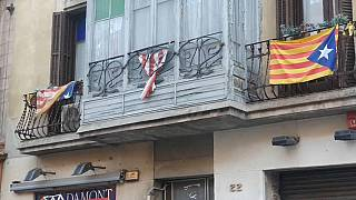 Catalan flags fly on buildings in Barcelona ahead of regional elections