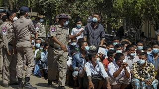 Prisoners, soon to be released marking the 74th anniversary of Myanmar's Union Day, wait for processing at the Insein prison in Yangon, Myanmar Friday, Feb. 12, 2021.