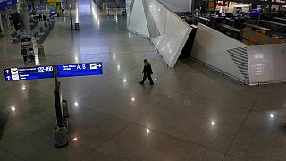 A security walks at the empty Eleftherios Venizelos International Airport