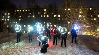 People draw hearts with their cellphones flashlights in support of jailed opposition leader Alexei Navalny and his wife Yulia Navalnaya Moscow, Russia, Sunday, Feb. 14, 2021.