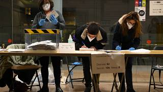 Officials recount postal vote's ballots after closing a polling station in the Ninot market in Barcelona during regional elections in Catalonia on February 14, 2021.