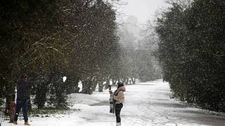 snowfall in central Athens. (AP Photo/Thanassis Stavrakis)