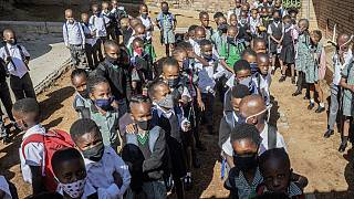 South Africa reopens schools, borders as virus cases fall