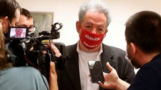 Andras Arato, Klubradio's director and CEO talks to the press after the court verdict in Budapest, Tuesday, Feb. 9, 2021.