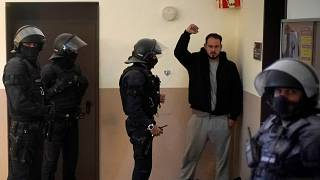 Rap singer Pablo Hasél is detained by police officers at the University of Lleida, Spain, Tuesday, Feb. 16, 2021.