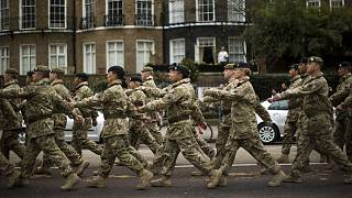 Members of the British military's 4th Mechanised Brigade parade through central London to attend a reception at the Houses of Parliament, Monday, April 22, 2013.