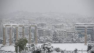 Snow covers the ancient temple of Zeus in Athens