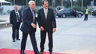 Cypriot President Nicos Anastasiades, right, welcomes the Foreign Affairs of Spain Josep Borrell