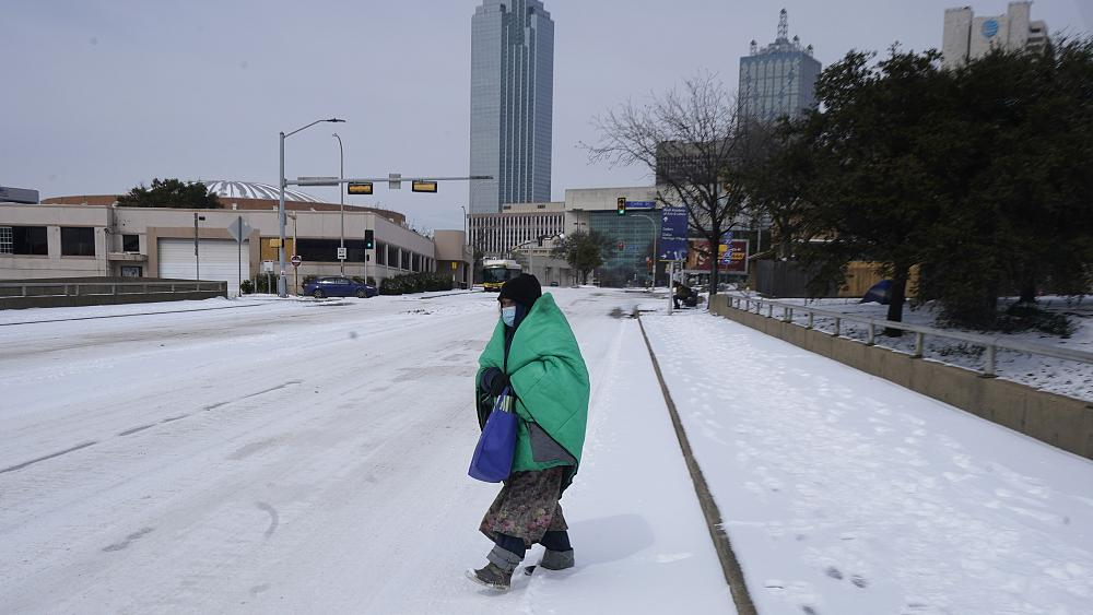 At least 20 dead as millions in US endure record cold without power