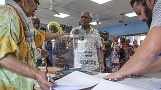 A man casts his vote in Noumea, New Caledonia, Sunday, Oct. 4, 2020, during a referendum whether voters choose independence from France.