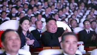 In this photo provided by the North Korean government, North Korean leader Kim Jong Un and his wife Ri Sol Ju watch a performance marking birth anniversary of Kim Jong Il