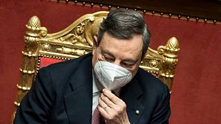 Italy's prime minister Mario Draghi addresses the Senate in Rome Wednesday, Feb. 17, 2021.