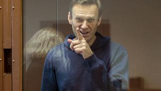 Russian opposition leader Alexei Navalny gestures during a hearing on his charges for defamation in the Babuskinsky District Court in Moscow, Russia, February 16, 2021.