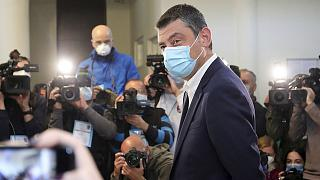 Georgia's Prime Minister Giorgi Gakharia speaks to the media after voting at a polling station during the parliamentary elections in Tbilisi, Georgia, Saturday, Oct. 31, 2020.