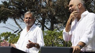 FILE: European Union's enlargement commissioner Johannes Hahn speaks during a news conference next to Albanian Prime Minister Edi Rama, right, in Durres in August 2017