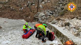 Italy's National Alpine and Speleological Rescue Corps rescue an injured man and his dog on February 18, 2021.