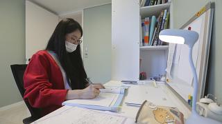 A high school senior studies at her home in Siheung, South Korea.