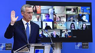 NATO Secretary-General Jens Stoltenberg gestures as he addresses a media conference following a virtual meeting of NATO defense ministers at NATO HQ in Brussels on Wednesday