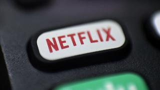 A logo for Netflix on a remote control.