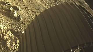 This high-resolution image shows one of the six wheels aboard NASA's Perseverance Mars rover, which landed on Feb. 18, 2021, taken by one of its Hazard Cameras (Hazcams).