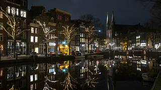 Deserted streets and bridges are seen during curfew in the center of Amsterdam, Saturday, Jan. 23, 2021.