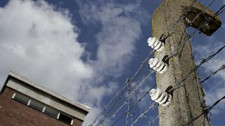 Barbed wire on concrete poles is seen at the memorial site of the former Nazi concentration camp 'Neuengamme'