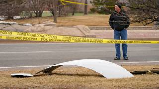 A piece of debris from a commercial airplane is surrounded by police tape on a strip along Midway Boulevard in Broomfield, Colorado. Feb. 20, 2021.