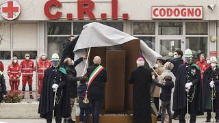 Authorities unveil a memorial for COVID deaths, in Codogno, northern Italy, Sunday, Feb. 21, 2021