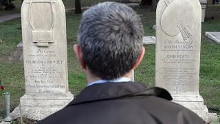 A man stands in front of the graves of English poets Percy Bysshe Shelley and John Keats at a non-Catholic cemetery in Rome, February 2006