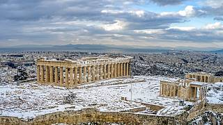 A rare sight of the ancient Acropolis covered in snow in Athens, Wednesday, Feb. 17, 2021