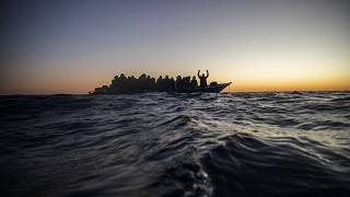 A crowded boat of migrants was intercepted 122 miles off the Libyan coast on February 12, 2021