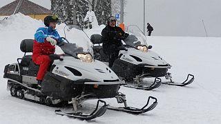 Putin und Lukaschenko auf Motorschlitten