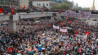 Anti-coup protesters gather at an intersection near the Sule Pagoda in downtown Yangon, Myanmar, Monday, Feb. 22, 2021.