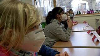 Wearing masks, children returned to primary schools in some parts of Germany on Monday.